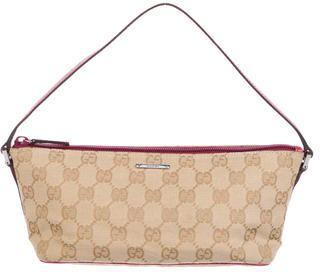 Gucci GG Canvas Pochette  https://api.shopstyle.com/action/apiVisitRetailer?id=624858749&pid=uid2500-37484350-28