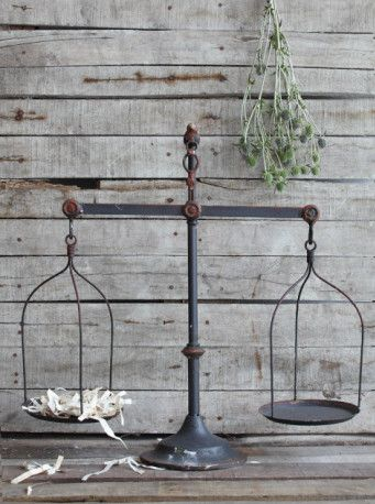 """Farmhouse Iron Scale-This amazing conversation piece is even adorned with a little bird on top. Farmhouse perfection. And full of charm!Farmhouse Iron Scale measures 23"""" long x 23 1/4"""" highThis is a pre-order item and will ship to you in 4-6 weeks."""