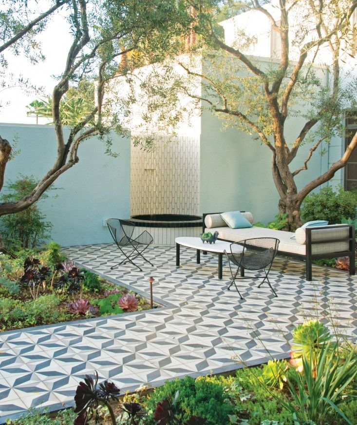 "Garden ""room"": Outdoor encaustic tiles act as a ""rug"", an extra wide Plain Air daybed and coffee table give the owners a place to read the morning paper, and a water feature muffles the sounds from the street, Succulents, esp Tree aeonium (Aeonium arboreum), 'Zwartkop' Potential ceemnt tile source: http://www.miracolour.de/cms/front_content.php?idart=57#2"