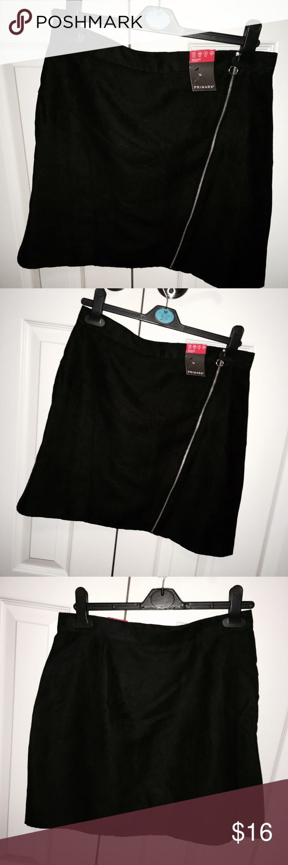 Black suede high wasted skirt with zipper Super cute black suede skirt – never been worn!! Great for a night out or something cute in the winter and fall season with boots. This piece is a size 8; tags still on it and in amazing condition. The Size 8 but fits like a size 6 because of the wrap around waist. This unique skirt comes with a chrome zipper that gives the look a subtle but sexy edge that every one is looking for. Atmosphere Skirts Midi