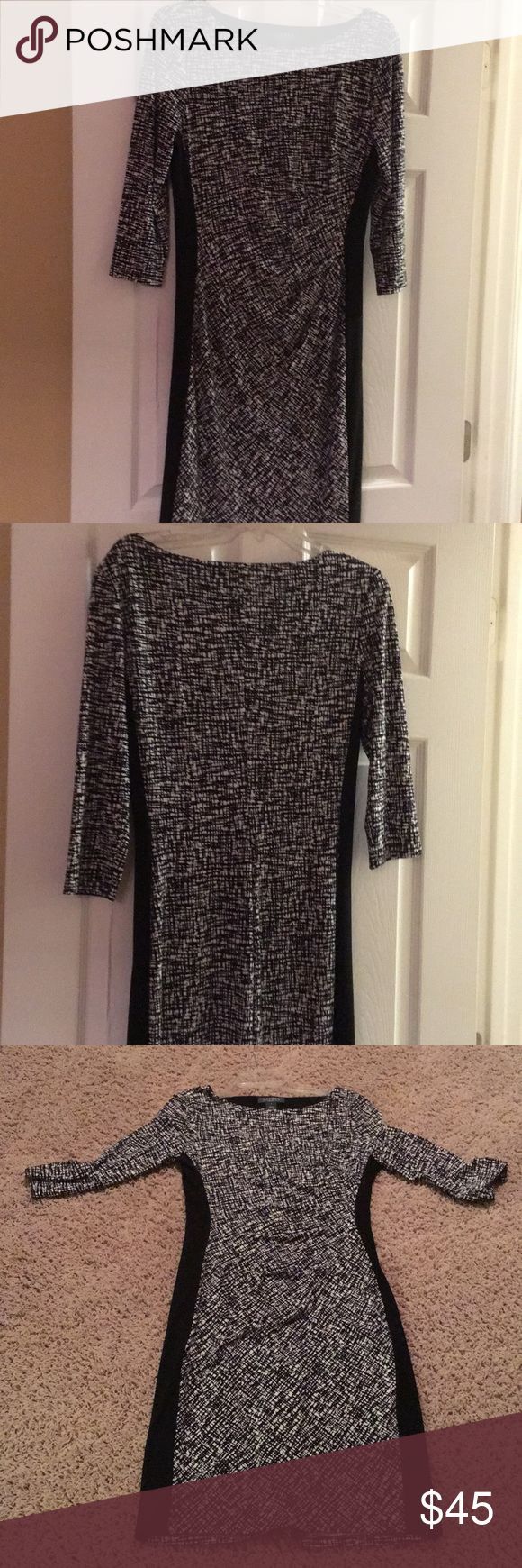 Ralph Lauren dress Beautiful Ralph Lauren dress. Side panels are black. Black and white pattern on front and back. Rushing in front to flatter any figure. Great for work or dress it up fro a night on the town with some bling. Lauren Ralph Lauren Dresses Midi