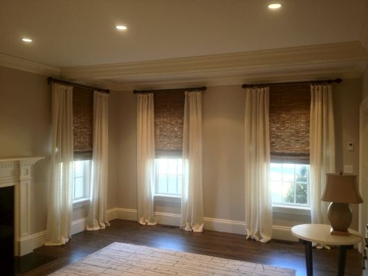 Custom Drapes with Woven Wood Shades, I thought to do this in our bedroom, seeing it has made it official. I WILL be doing this.