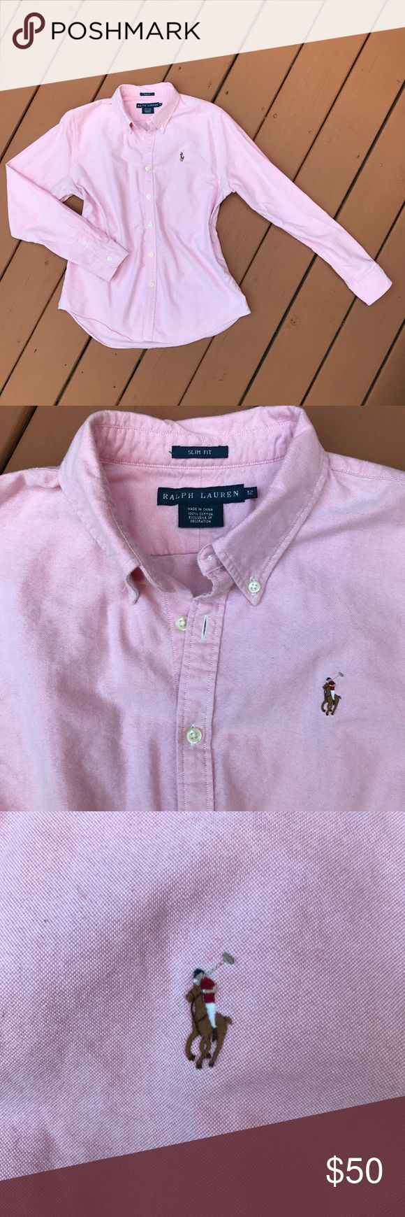 Classic Ralph Lauren Button Down in Pink Sz 12 Pink Classic Ralph Lauren shirt. A washed cotton oxford and a trim fit join forces in this modern take on the classic shirt. Our signature embroidered pony finishes the piece in pure Polo Button Down style.  Custom Fit: a trim silhouette without stretch. Button-down point collar. Buttoned placket. Long sleeves with buttoned barrel cuffs. Back yoke. Shaping darts at the back. EUC Multicolored signature embroidered pony at the left chest. Ralph…