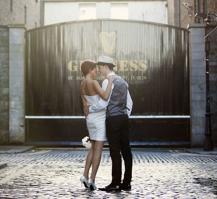 Pikki and Lorcan on a wedding day reshoot at sunset outside the black gates of the Guinness Store House.