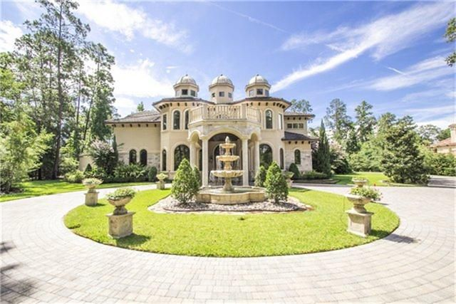 Dream Home: Gated entry with circular pavestone drive with portico entry featuring limestone columns.  Center landscaped