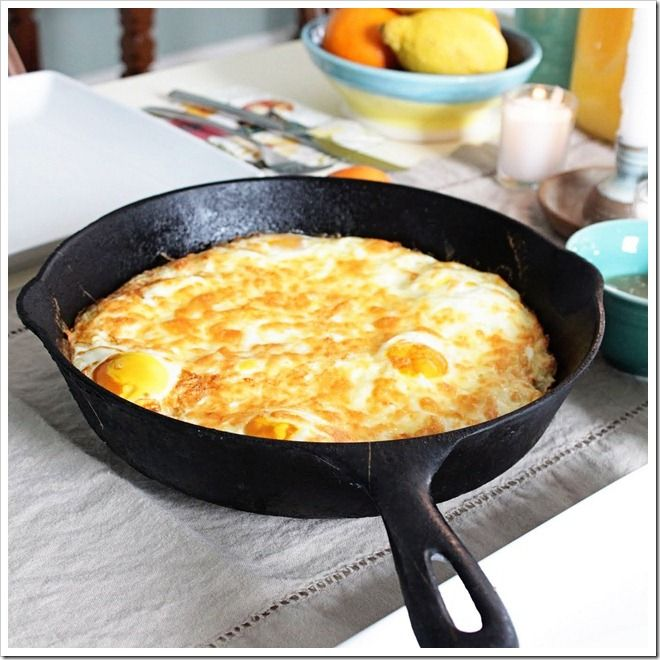 Baked eggs with crispy hash brown crust - great for brunch.  Eggs topped with cheese, baked in a cast iron skillet, with a crispy hash brown crust hidden below.  This one is much simpler than it looks. It's really only three ingredients: potatoes, eggs, and cheese. I love recipes that use ingredients I almost always have stocked.