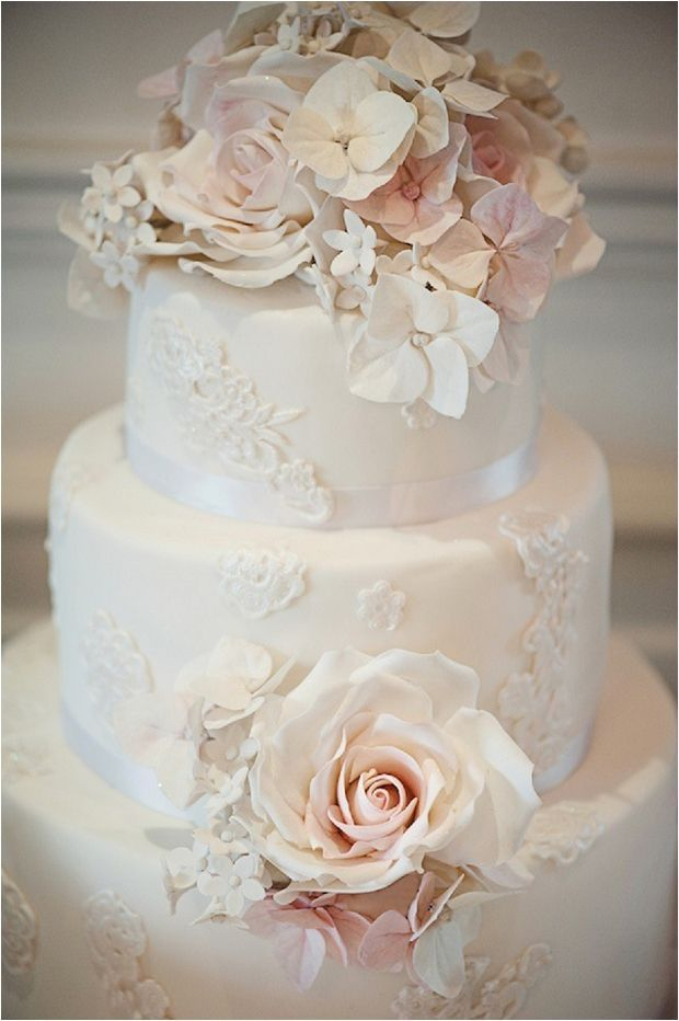 White Lace cake for wedding with pink sugar roses and hydrangeas
