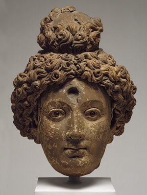 Head of a bodhisattva, 5th–6th century  Afghanistan, probably from Hadda  Clay or terracotta, garnet