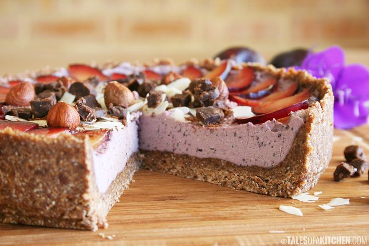Healthy and paleo plum and poppy seed cheesecake with hazelnut cacao crust