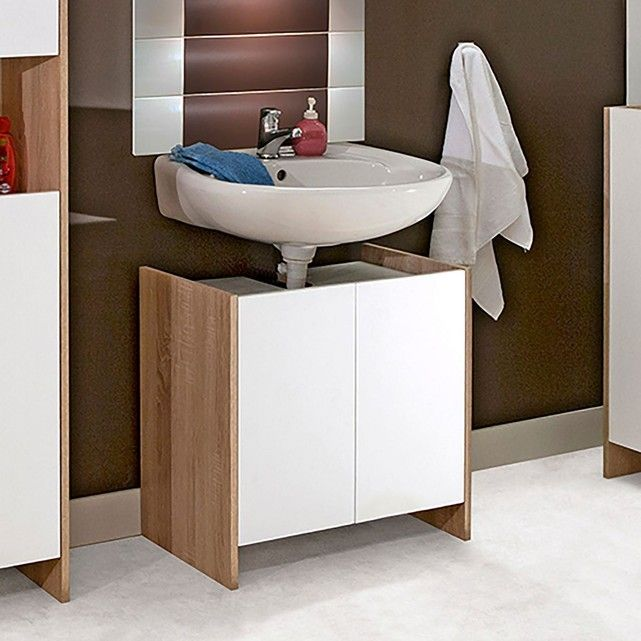 Le meuble de salle de bain sous-lavabo, 2 portes Banero offre un grand volume de rangement.Descriptif du meuble de salle de bain sous-lavabo, 2 portes Banero :- 2 portes fermées par aimant.- Charnières invisibles (réglables à rappel automatique).- Découpes pour le passage de la bonde.- Patins d'isolation.Caractéristiques du meuble de salle de bain sous-lavabo, 2 portes Banero :- En panneaux de particules mélaminés, épaisseur 16mm, finition coloris chêne clair et blanc pour les portes.Di...