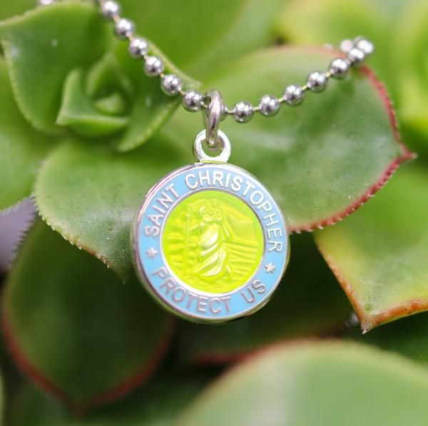 Dainty lustrous St. Christopher medallion rendered on our standard ball chain necklace with options to upgrade the style chain to fit your vibe. The medallion h