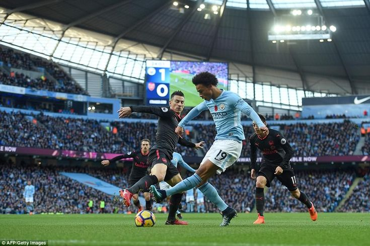 Sane toys with Laurent Koscielny as City look to press home their advantage and extend their lead over Arsenal