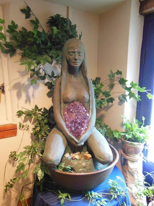 A fountain statue by Phillipa Bowers in the Star Child shop in Glastonbury.