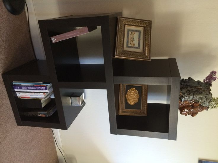 Furniture:The Close Look Of Black Cube Wall Shelves Ikea In The Interval Design With Beautiful Islamic Calligraphy And Artistic Sculpture With Some Books Comfy Interior with Cube Wall IKEA Shelf for Neat Storage