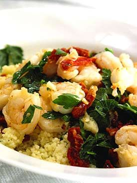 Sautéed Shrimp and Tomatoes with Lemon Couscous serves 1 1 box quick couscous Zest and juice of 2 lemons 1 large bunch parsley, minced 2 tablespoons butter 2 garlic cloves, minced 1/3 cup julienned sundried tomatoes, plumped in a little hot water 1 cup white wine 1/4 pound fresh shrimp