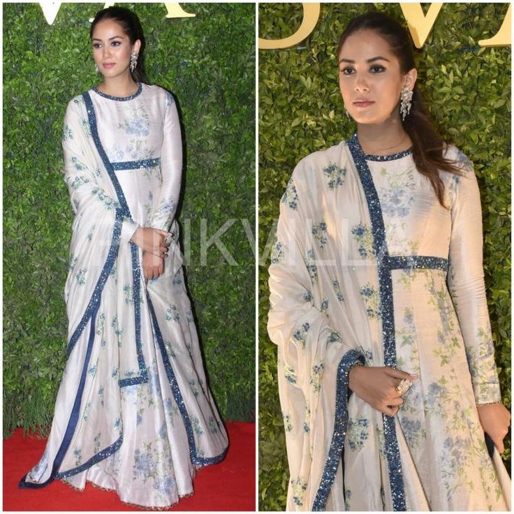 Mira Kapoor in a white and blue floral print Anarkali from SVA by Sonam and Paras Modi's latest collection, that she paired with matching sequined border dupatta. Hair tied up in a ponytail and dangling pair of diamond earrings rounded her look out.