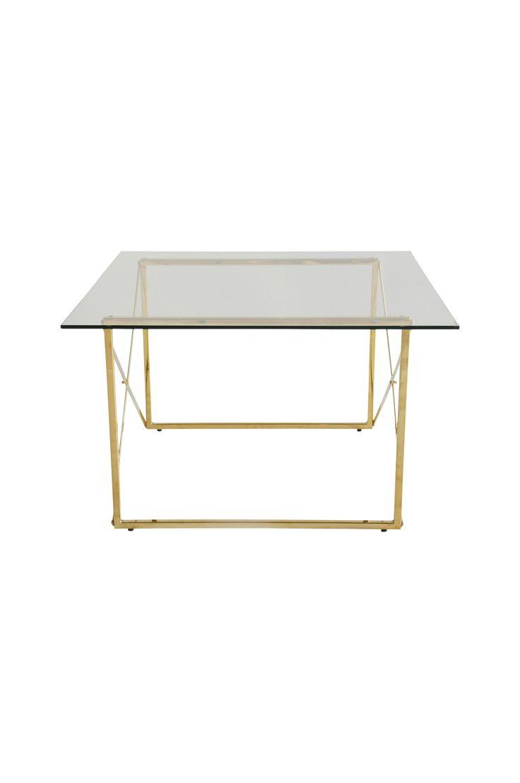 """Klassiskt soffbord i färgad metall och härdat glas. Bordet andas rymd med det nätta underredet och skivan av glas. Mått 75x75, höjd 46 cm. Montera själv. Vikt 12 kg. Läs om fraktavgiften under fliken """"Leverans""""."""