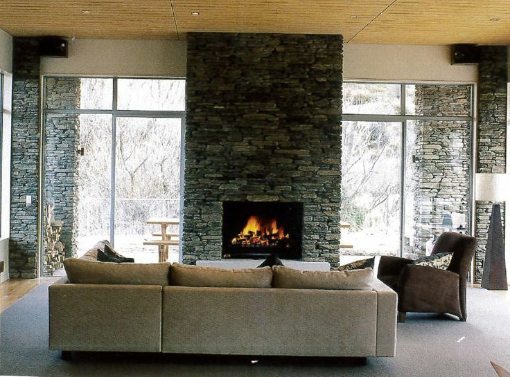 Interior stone wall around fireplace.