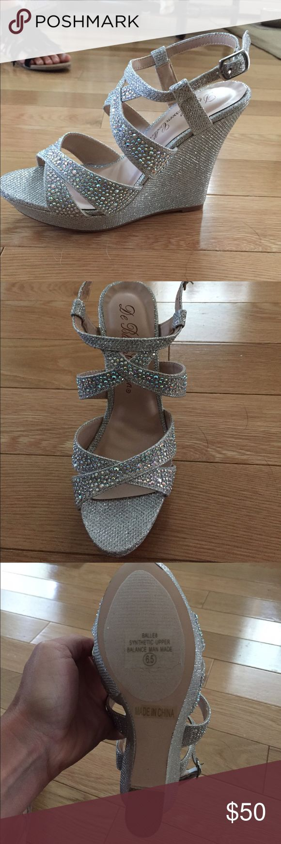 De Blossom Collection Silver Wedge Sandal David's Bridal-De Blossom Collection Beautiful silver wedge sandal. Brand new, never worn, with box! We ordered a bunch of these for the bridesmaids in my sisters wedding and forgot to return within the 14 day period....I have a 6.5 and 7.5 for sale... they run small and narrow! Im usually a 6 and ended up wearing a 7. Super comfortable for a wedding! Danced all night in these! Davids Bridal  Shoes Wedges