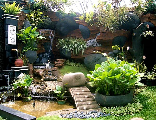 Small tropical garden ideas for home from agit landscape for Backyard plant design ideas