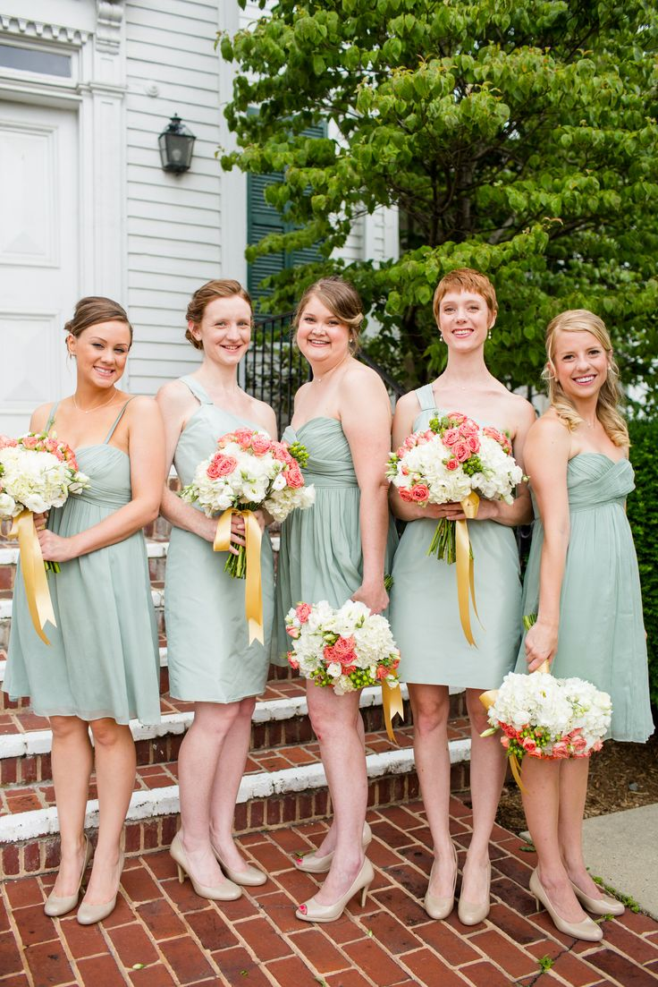 Fun bridesmaids poses with dusty shale dresses and coral and white flowers. This was such a fun group to work with. Click the photo to read more about this coral wedding.