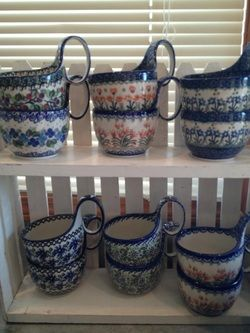 These curved soup mugs are a 'hot' item to have.  Use them to serve soup or stew..your hand stays warm while you enjoy that cup of chicken noodle soup.  perfect for those special occasions sitting on a couch with a fuzzy blanket or a child sick in bed.  Each handpainted and available at: www.morepolishpottery.com  We also use it for dips, candy, and more.