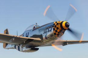 """Warbird Heritage Foundation.North American P-51D Mustang.Year Built:1944.Constr # /Plant:122-31945/ Inglewood,CA.Serial44-72086 (USAAF)N-Number:N251PW.Engine:Packard """"Rolls Royce"""" Merlin V-1650-7 liquid-cooled supercharged V-12 1,490hp./1,720hp. at WEP.Length:32ft.3in.Height:12ft.2in.Span:37ft.Empty:7,635lbs.Max Takeoff:12,100lbs.Range:2,30 miles -1,200 miles - Internal fuel.Ceiling:41,900ft.Stall:100Mph.Cruise:362 Mph.Max: 437 Mph. at 25,000 ft."""