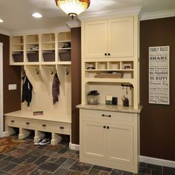 Mudroom with mail sorting counter...love this idea, store paper recycling bins in lower cabinet. A spot for your keys, purse, phone charger. Brilliant!