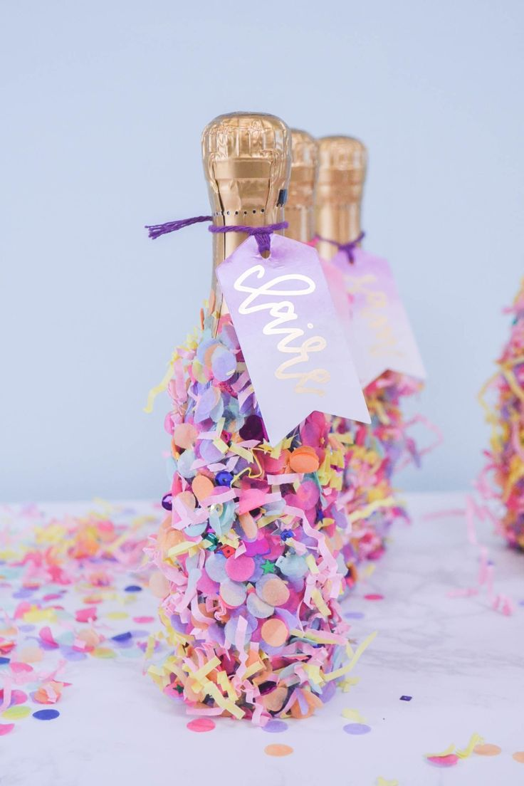 Bachelorette party favor idea - mini confetti-covered champagne bottles with watercolor tags for bachelorette party favor