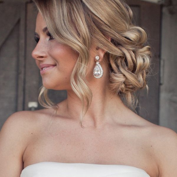 If you have a layered cut, leave out some curls to softly frame your face. Add sparkling chandelier earrings or a headband to complete the romantic vibe.