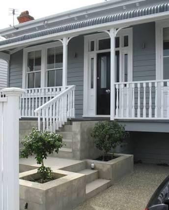 Black door, grey with white trim nz renovations cladding White blue grey