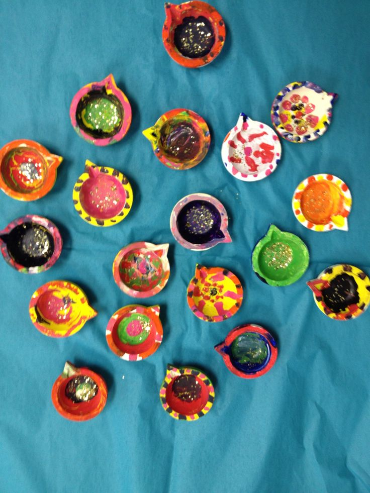 Painted clay diyas for Diwali - sent home with a tea light.
