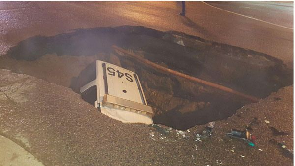 Sergeant scrambles to safety after sinkhole swallows his police SUV | FOX31 Denver  JUNE 5, 2015