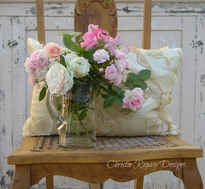 Cane bottom chair holds the pillow and flowers by Christis Repasy Photography