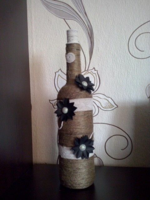 Twine wrapped wine bottle with paper flowers