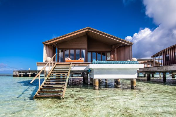 Island living at its finest. Private villas in the Maldives feature staircases leading into turquoise oceans brimming with marine life - perfect for a dip at any time of the day.