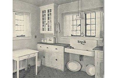 1920s craftsman kitchen- we should do these drawer pulls and add order glass doors