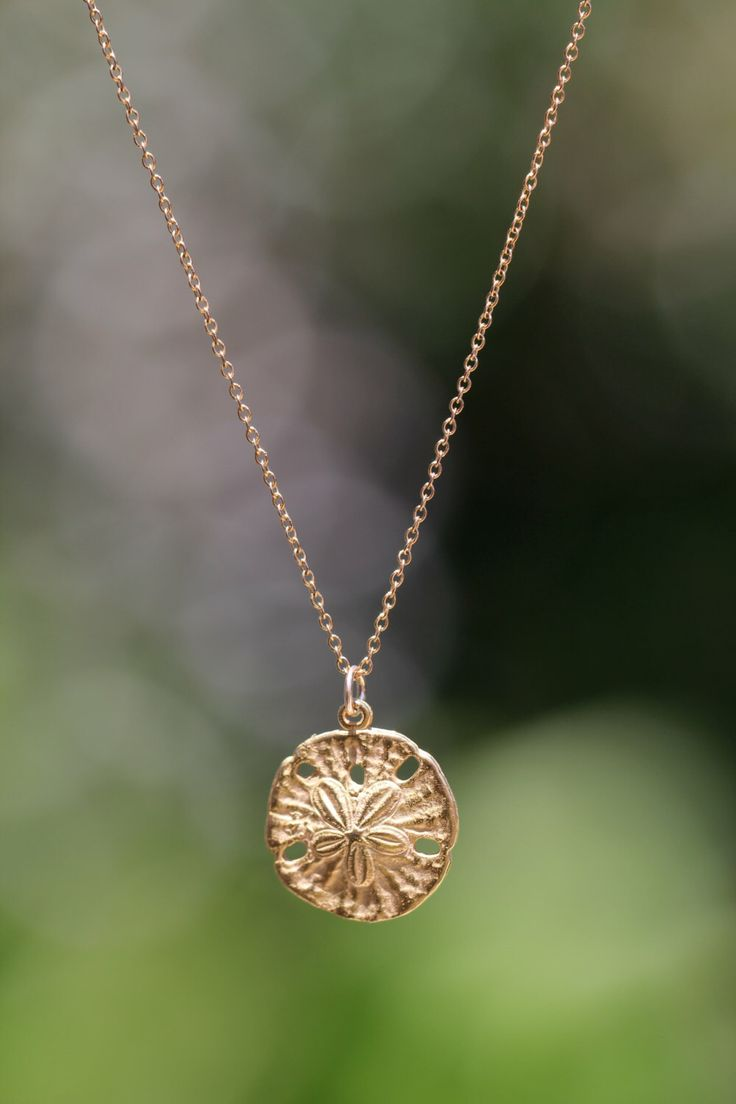 Gold sand dollar necklace - delicate necklace - a dainty gold sand dollar hanging from a 14k gold vermeil chain by BubuRuby on Etsy https://www.etsy.com/listing/151727973/gold-sand-dollar-necklace-delicate