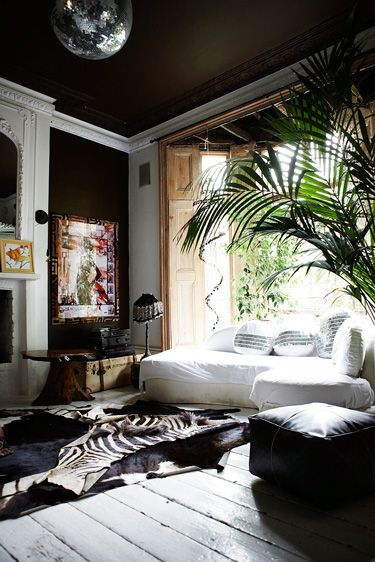 boho eclectisism in london. black, white, wood and green green plants + a bit of sparkle.