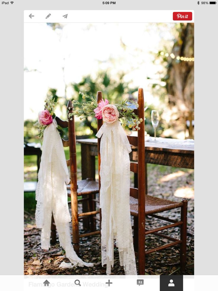 love everything about this. The arrangement and the material used for the hanging fabric (we can source that part). This is an optional arrangement. If the cost is high these will be the first to go.