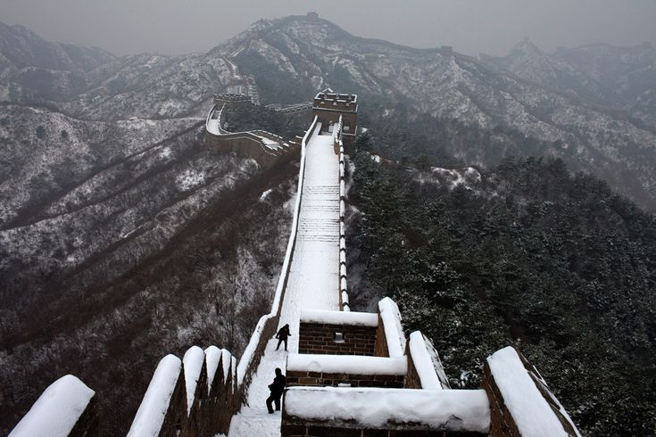 Tourists climb the Great Wall after a snow in Luanping, China on December 14, 2012. (Alexander F. Yuan/Associated Press)