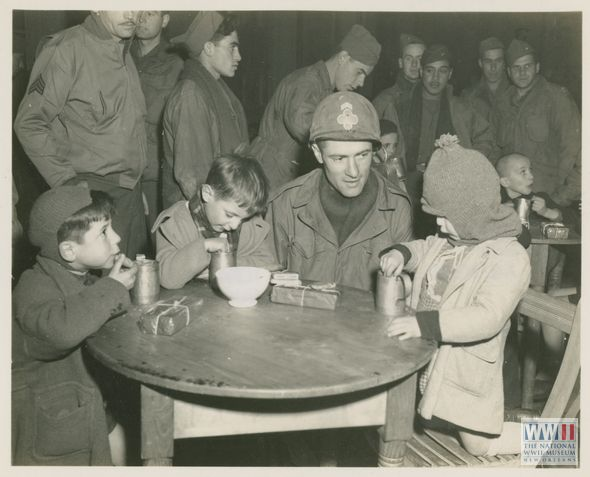 American servicemen with Italian orphans at a Red Cross Christmas party (1944)
