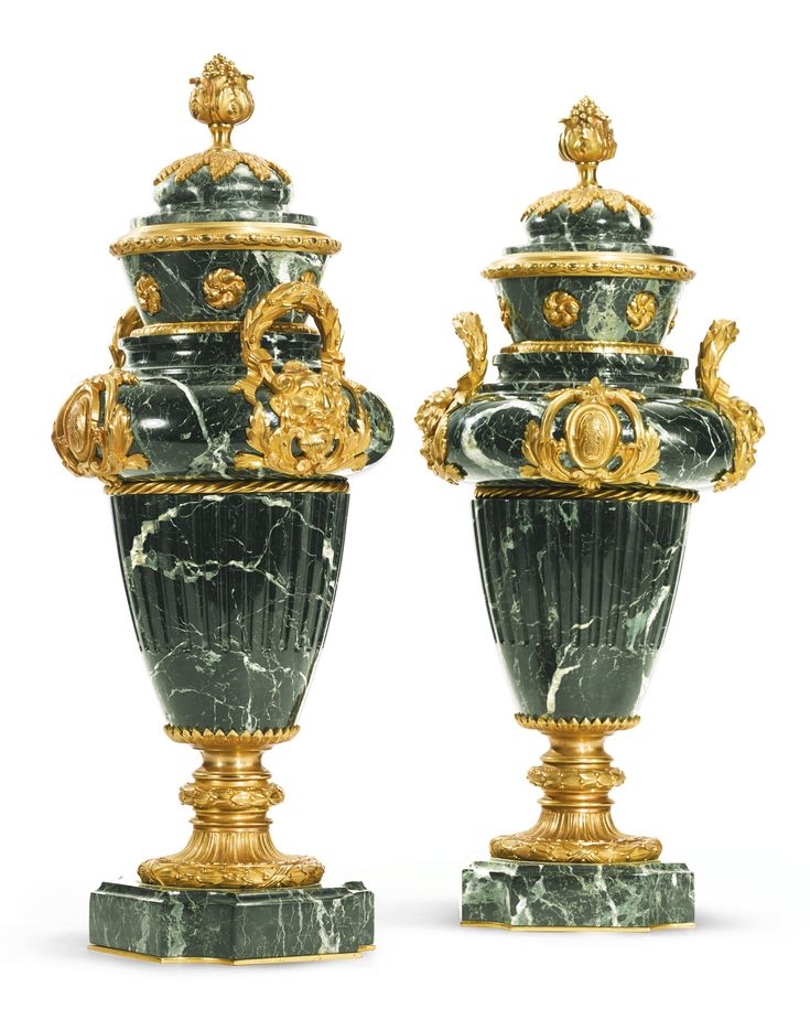 A pair of gilt-bronze mounted green marble lidded …