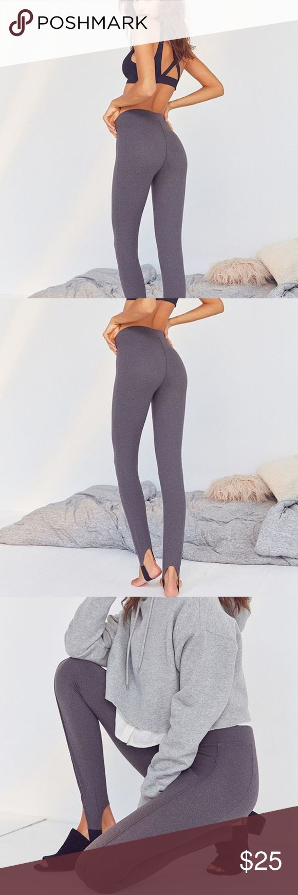Out From Under Big Spoon Stirrup Leggings Legs for days in these '80s-inspired stirrup leggings by Out From Under. Seamed leggings with a high-waisted fit in a stretchy knit featuring stretchy stirrup banding that wraps around heel. Pair with your favourite heels for a throwback look that commands the room. Urban Outfitters Pants Leggings