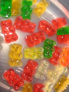Vodka-soaked Gummi Bears (A hit at parties.  I like using Fruit Punch Vodka.  Soak in the fridge for 2+ days, until they're soft all the way through, & serve on toothpicks - way too sticky for fingers!)