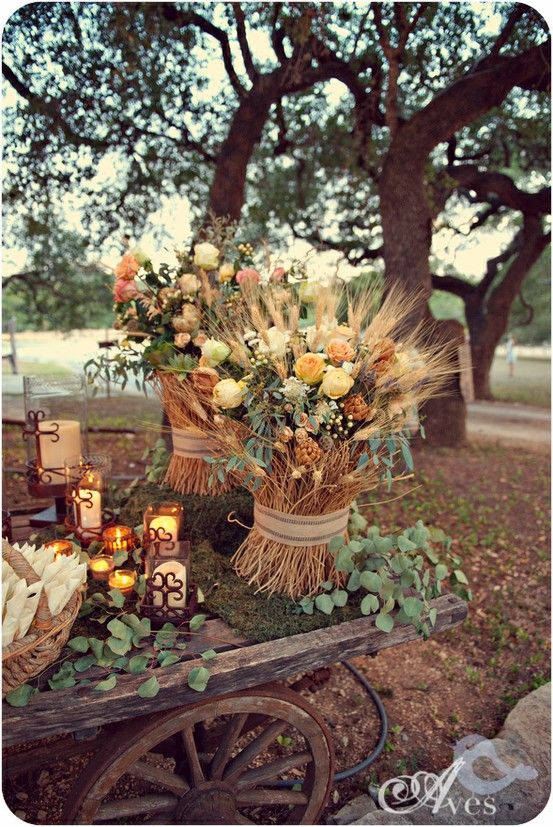 An old farm wagon acts as decor for an outdoor, autumn wedding / Embellished…