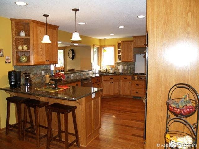 Kitchen redo oak cabinets yellow walls black counters for Kitchen pictures with oak cabinets