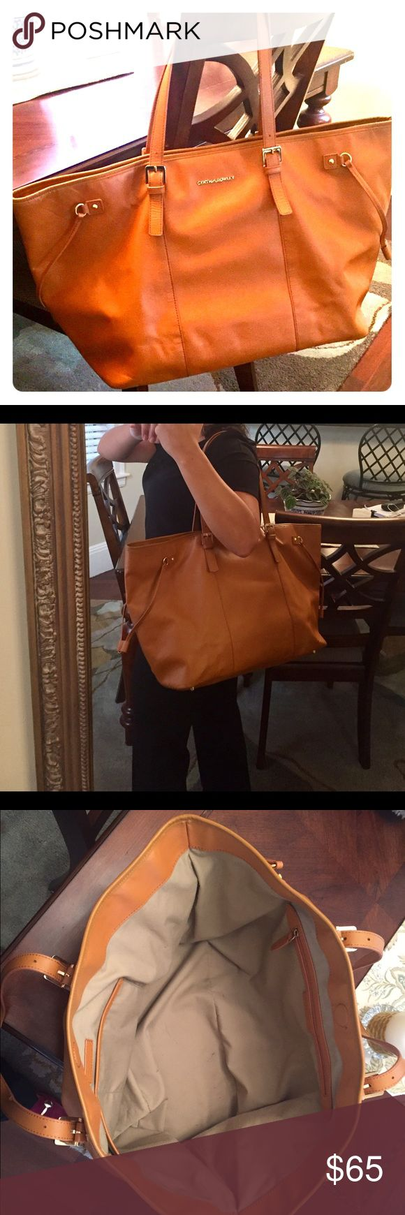 "Cynthia Rowley Tan Leather Extra Large Tote Bag Perfect carry all for a busy day or overnight. Dark tan is versatile for any outfit! Comes with a dust bag. Gently used and some minor scuffs. I am 5'1"" bag is a little too big for me, why I am selling. Cynthia Rowley Bags Totes"