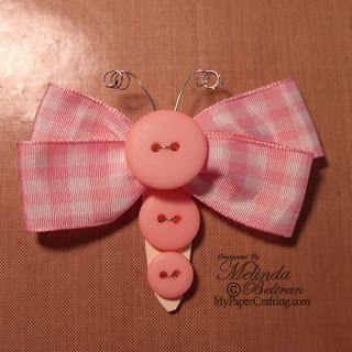 moño mariposa con cinta y botones