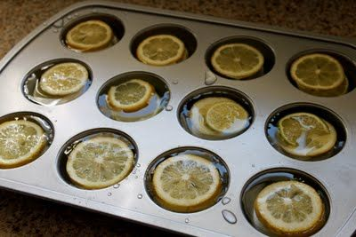 Large ice cubes with lemons for pitchers.